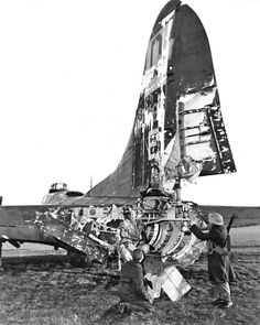 The B-17 Flying Fortress was famous for its durability. This B-17, Hang the Expense, of the 100th Bomber Squadron of the USAAF rests in an English airfield after being severely damaged by flak over Ostend on an aborted mission to Frankfurt, Germany, 24 January 1944. The tail gunner, Roy Urick, was blown out - but survived and was taken prisoner. Pilot, Frank Valesh, and co-pilot ,John Booth, miraculously flew the badly damaged B-17 back to England and put down safely at Eastchurch.