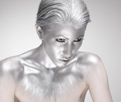 Silver body paint...or a statue. Either way, beautiful.
