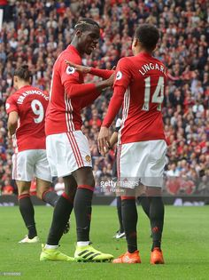 Paul Pogba of Manchester United celebrates scoring their fourth goal with Jesse Lingard during the Premier League match between Manchester United and Leicester City at Old Trafford on September 24, 2016 in Manchester, England.