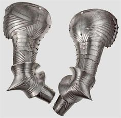 A pair of German Gothic brassards, circa 1489/90 Large pauldrons sliding on one lame. The large spaulders with pointed fluting. The edge offset by double grooves, each with one large hole for fixation on the collar.