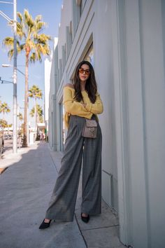 Yellow oversized sweater+grey checked wide-leg pants+black pumps+taupe crossbody bag+sunglasses. Fall Dressy Casual Outfit 2017