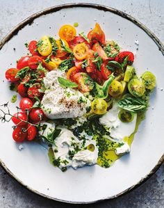 This light salad—a great way of using up leftover pesto in your fridge—is best served in the summer, when tomatoes are at the peak of their season!