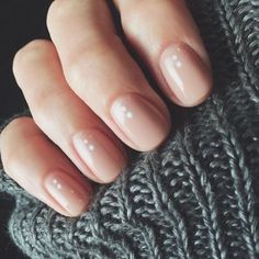Minimalistic Nude Nails With White Dots