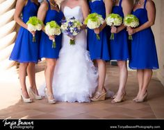 Bridesmaids holding the bouquets. Blue bridesmaid dresses with green bouquets! Ponte Vedra Beach Florida  TPC Wedding Photos - Ponte Vedra Wedding Photos -  Tonya Beaver Photography 008