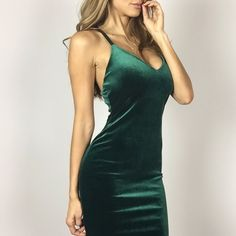 "🎁 Emerald Velvet Midi Dress A stunning Holiday dress in lux velvet. The dress is a gorgeous deep Emerald color and features a criss cross back style. Fabric has great stretch and comfy. Be the life of the Holiday party. Fully lined. True to Size. M measures 14"" across chest, 44"" in length. 90%Poly 10% Spandex. Boutique Other"
