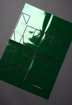 """Prada S/S 2011 invite - angular typeface on green plastic."""