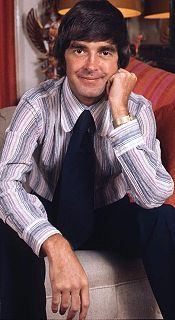 """Derek Robert Nimmo (19 September 1930 – 24 February 1999) was an English character actor, producer and author. He was particularly associated with upper class """"silly-ass"""" roles, and clerical roles. (Just A Minute) Nimmo was checking an external alarm when he lost his footing and fell down a stone staircase into the basement. He suffered head injuries and was taken to the Chelsea and Westminster Hospital where he remained in a coma until his death in February 1999."""