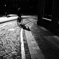 Streetlife in Utrecht #bike #utrecht #utrechtcity #bnwmood #bnw #bnw_city #bnw_life #bwlove #bwstyles #bwlover #blackandwhitephotography #streetphotography #streetstyle #mood #byme #photolovers #fineartimages_nl #shadow #light_shots #beautifullight #light #blackandwhitestreetphotography #holland