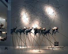 Zoo. Dinamic display, a chaos of sticks, shoes, string and trumpeting elephants. photo by Ion Ander Beloki