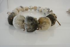 taxidermy mouse necklace.
