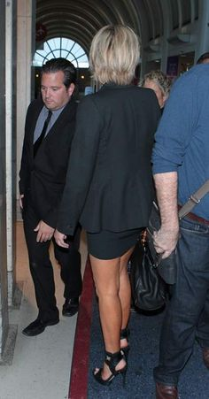 photo Sharon Stone wearing a black suit and spiked heels April 13-2015 007_zpsmpuyoauv.jpg