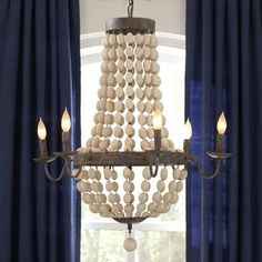 Draped with wooden beads in soft, neutral hues, the Addington Chandelier brings warmth and elegance to any room. #soft #neutral #hues