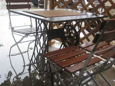 Tables made out of old Singer sewing machine bases!