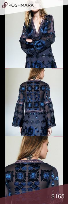For love and lemons Barcelona a line mini dress Barcelona a line dress. Seventies inspired printed mini dress featuring cutout trim, in an A-line silhouette. V-neckline with long flared sleeves. Lined. For Love and Lemons Dresses Mini