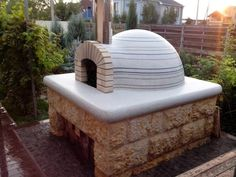 Casa Pizza Oven by Forno Bravo finished by a very patient owner with amazing tile laying skills! #tiledpizzaoven