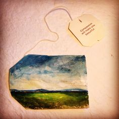 Landscape painted on a recycled Tea Bag ... one of the newest forms of art.