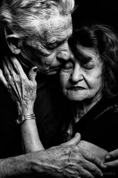 True love. Hugg, gentle, gesture, hands, beauty, old people, intense, affection, emotion, faces, aged, lines of life, portrait, photo b/w.