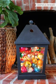Fill a hurricane or lantern with ornaments and battery powered string lights for outdoor lighting