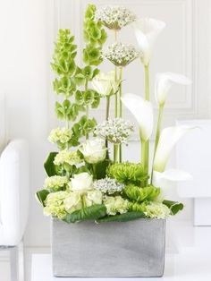 This exceptional display is the ultimate statement piece. The pristine white velvety petals of the calla lilies reach elegantly upwards, surrounded by a perfectly balanced arrangement of the very freshest pure white allium and stunning green roses and chrysanthemums. This is a designer gift that is the essence of contemporary chic. http://www.interflora.co.uk/catalog/product.xml?product_id=2572746;=1