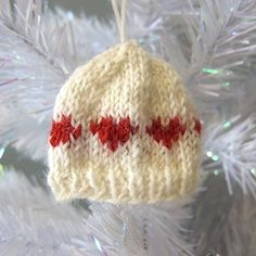 Knit up tiny hats to decorate your tree and presents with these free patterns.