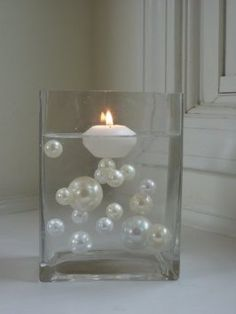 Floating pearls for wedding centerpieces easy simple and people can see over them :)