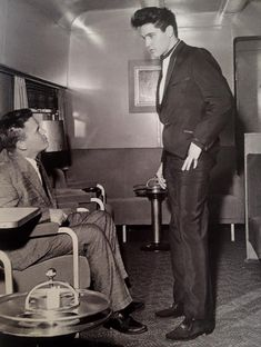 "Wednesday, April 20, 1960: Elvis (25) and 21-year-old friend and bodyguard  Delbert ""Sonny"" West (* 1938) are pictured aboard a train heading to Hollywood to film his first post-Army movie ""G.I. Blues.""  Two days ago, on Monday, April 18, 1960 Elvis had boarded his Hollywood-bound train at Memphis Central Station. Photo by photographer Neil Clemans. Take a look inside the FTD book ""Elvis Presley From Memphis To Hollywood"": https://www.youtube.com/watch?v=PPFEND8Ovmo"