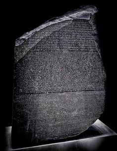 The Rosetta Stone, 196 BC; a fragment of a larger basalt steele, was written in Egyptian hieroglyph, Demotic (a shorthand) and Greek. Found by Napoleon's French soldiers while building a fort, it is now in the British Museum, London.