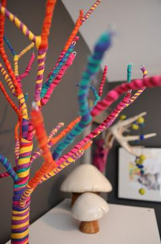Yarn Bombed twigs and branches. I would go with one solid grown up color like mint or black for a chic grown up version