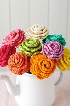 crochet flowers. find a cute teapot or old flowerpot at a thriftstore, fill it with these, make adorable decoration.