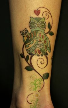 Ashley Miller's tattoo of a mother owl with her two babies. Ink done by Danielle Miller at Only You Tattoo in Atlanta, GA. Original owl art by Annette Mangseth.
