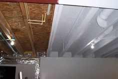 An option instead of drywall or drop ceiling--- paint it all with an Airless Sprayer in white to make it uniform but blend in and bright. Open Basement, Basement Laundry, Basement House, Basement Bedrooms, Basement Ideas, Basement Bathroom, Basement Finishing, Basement Apartment, Basement Designs