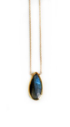 The color & flash in our labradorite drop necklace is spectacular! Its amazing in person. The aprox. 22mm vermeil drop bezel is suspended from a 14k gold filled chain. It looks great when layered with other of your favorite pieces.
