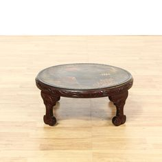 This coffee table is featured in a solid wood with a glossy rosewood finish. This Asian style cocktail table has a top with an painted domestic scene, intricately carved trim, and carved trim. Elegant piece that's perfect for any living room! #asian #tables #coffeetable #sandiegovintage #vintagefurniture