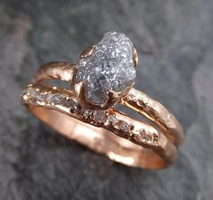 Raw Diamond Solitaire Engagement Ring Rough 14k rose Gold Wedding Ring diamond Wedding Set Stacking Ring Rough Diamond Ring byAngeline   *********(Diamond band sold Separately)**********  This diamond ring is available here, this one is a size 7 and can be sized or I can create one like it custom. I created a rustic texture in the solid 14k rose gold. The diamond measures about 8mm X 5mm.  Through out all of time and history in every tribe and culture all around the world crystals minerals…