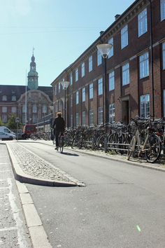 Simple cycle track with cobblestone buffer, Copenhagen. Click image for link to full profile and visit the slowottawa.ca boards >> http://www.pinterest.com/slowottawa