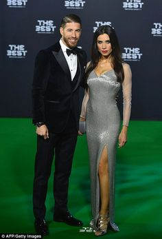Sergio Ramos, wearing a black dinner suit, alongside his wife, Spanish TV presenter Pilar ...