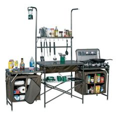 Take campout cuisine to a whole new level of convenience when you set up Cabela's Deluxe Camper's Kitchen. Powder-coated aluminum frame and heavy-duty 600-denier polyester compartments set up quick and easy so you're ready to start cooking immediately. Features two hanging pantries, five customizable shelves, durable melamine tabletop, bottom steel storage rack, and PVC sink. Inc