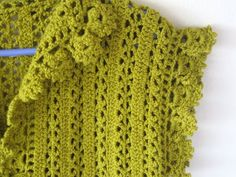 Beautiful spring crochet bolero, crocheted vertically. Wish I had the Japanese book this pattern came from. Click the photo and scroll down the web page to see the basic construction which looks pretty simple. Find a nice stitch pattern and you can probably make something similar.