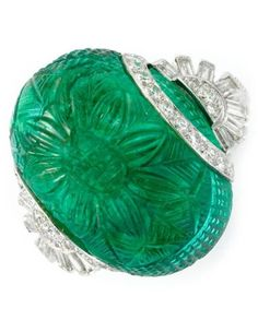 An Art Deco Carved Emerald and Diamond Ring, circa 1930. #ArtDeco #ring