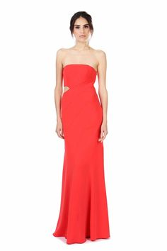 "DOYLE CORAL RED GOWN  was $524 now $157  STRAPLESS PANELED GOWN WITH SIDE CUT OUT IN OUR SIGNATURE CREPE FABRIC. SIDE CLOSURE WITH ZIPPER AND HOOK AND EYE. ARCHITECTURAL DESIGN AND GEOMETRIC CUT OUT MAKE FOR A CHIC GOWN IN BOLD COLOR.   SHOULDER TO HEM MEASUREMENT 37"" 98% POLYESTER 2% SPANDEX DRY CLEAN ONLY"