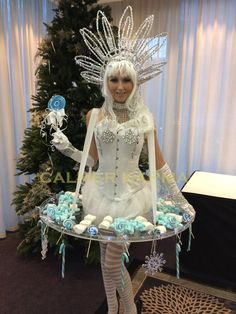 Winter Wonderland themed entertainment to hire -  Winter Kisses canape hostess mingling with guests.  http://www.calmerkarma.org.uk/winter-wonderland.htm    Perfect for corporate Christmas parties.   Hire across the UK inc MANCHESTER, LONDON, Cheshire, BIRMINGHAM, CARDIFF, Bristol
