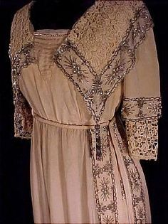 """c. 1912 Fabulous Ecru Silk Crepe Beaded Evening Dress with Lace and Beaded Tassels. This fine silk crepe evening gown exhibits the favorite features of the period - the classic Empire waistline (corded for emphasis), luscious tunic skirt; pleated and pearled """"vee"""" neckline, and two-layered sleeves! The gown is extensively adorned with pearl and bugle bead trim, on the exquisite large lace collar, sleeves and tunic, and on the tabard-type slit up the skirt's left side.Detail"""