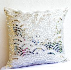 Ivory white throw pillow covers in art silk with exquisite silver sequin and thread work in a wave form. Inspired by sashiko pattern that depicts