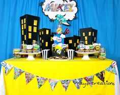 Superhero/Comic party! Love the buildings as the background and the comic banner!