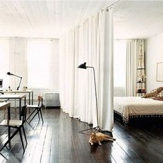 Something like this ceiling track solution for a curtain to close off the loft would be veddy niiiiice. if we choose an interesting design it can overhang and look coooool.