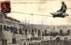 "Promotional postcard/pitchcard for sideshow stunt shooter and high wire artist D'Jelmako, crossing over a crowd on an invention of his called ""Aerial Torpedo"""
