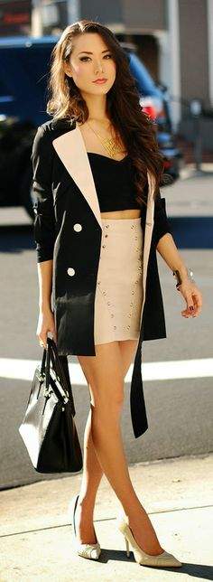 Gorgeous gold studded modern skirts with top black blouse and cute blazer and black leather hand bag and nude pumps the best street style.