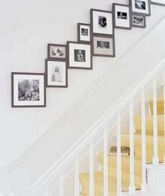 "For my staircase;) A new take on a staircase wall gallery: ""Lining a staircase with family photos is a classic tactic, but you can really give them impact by making a tight arrangement in frames of the same style and color, in three or four sizes. Stairway Photos, Stairway Gallery, Staircase Pictures, Stair Gallery Wall, Stairway Art, Gallery Walls, Photo Arrangements On Wall, Display Family Photos, Home Organization"