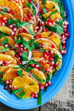 An all-star Mediterranean orange and pomegranate salad recipe. An easy, light, fresh and festive salad w/ sweet oranges, pomegranate seeds and fresh mint!