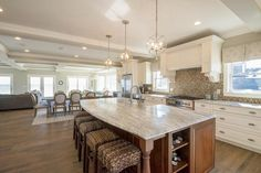 Traditional Kitchen with Ceramic Tile, Carrara White C/D Marble Countertop, Farmhouse Sink, Pendant Light, Raised panel